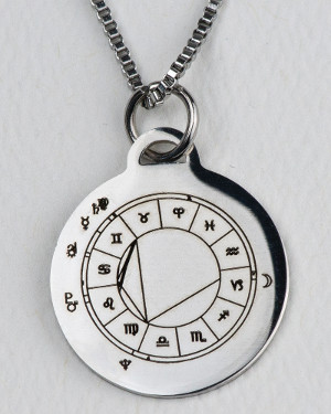 Silver-colored StarCharm pendant engraved with a natal chart